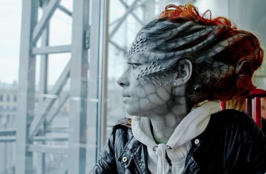 Halloween. Fantasy woman dragon on the street
