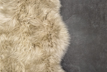 Sheep fur Sheepskin rug background stone texture