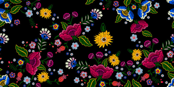 Embroidery native seamless pattern with simplify flowers. Vector embroidered traditional floral design for fashion wearing.