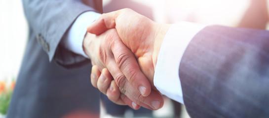 concept of cooperation.businessman handshake invites to cooperat