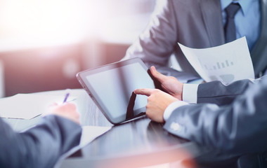 Businessman holding digital tablet at meeting