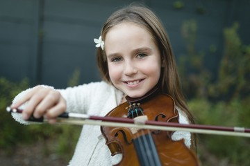 Girl playing violin in the park