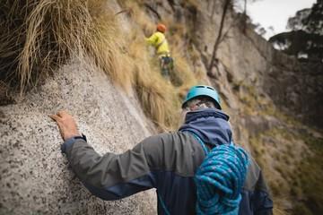 Man climbing a mountain
