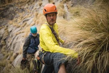 Portrait of man climbing mountain