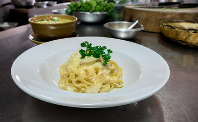 Spaghetti Carbonara in commercial kitchen