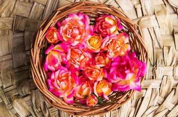Wild roses in a wicker bowl