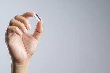 Hand holding refill staple, an office supplies for stapler