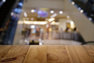 Empty dark wooden table in front of abstract blurred background of cafe and coffee shop interior. can be used for display or montage your products