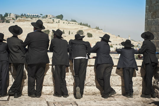 Orthodox Jew students of Yeshivah stand in front of the Western Wall