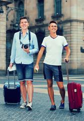 guys are walking around the European city