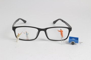 a Min of worker clear reading glasses
