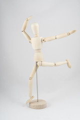 a wooden dummy posing while running