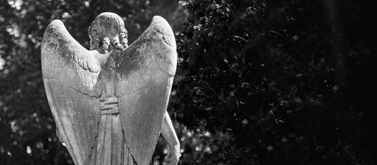 Fototapete - Rear view of angel of death as a symbol of the end of life. Ancient statue. (Religion, eternal life, immortality, faith concept)