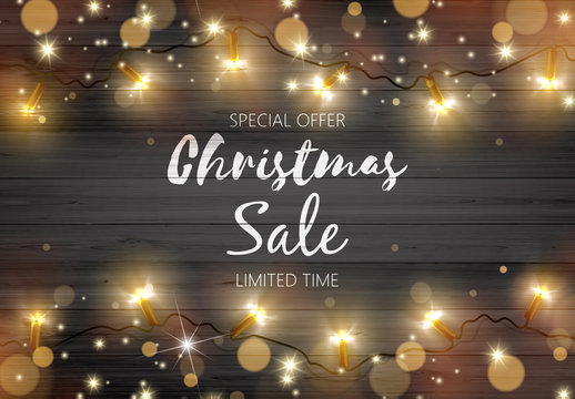 Vector Illustration of Christmas Sale Hand Drawn Lettering on Black Rustic Wooden Board with Golden Color Christmas Lights.