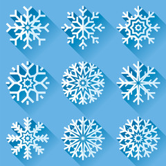Snowflakes icon set in flat style on blue background. Ice crystal. Vector winter design element for you Christmas and New Year's projects
