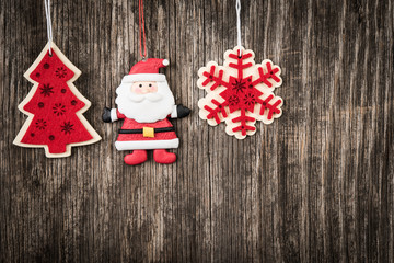 Red Christmas decorations over rustic wood