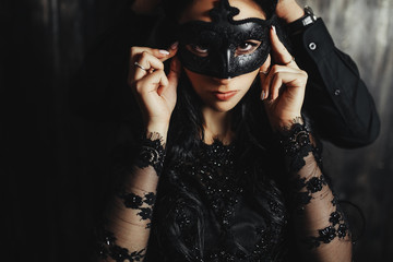 woman  with  theatrical mask and handsome man