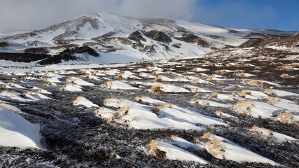 Etna volcano, snow formations molded by the wind, Nicolosi , Sicily, Italy