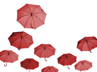Red umbrellas seen from below, isolated on white.