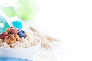 Delicious oatmeal porridge with berries and nuts