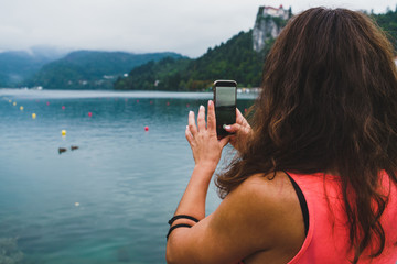 Woman taking shots of lake