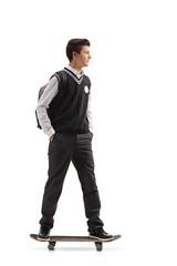 Teen student riding a skateboard