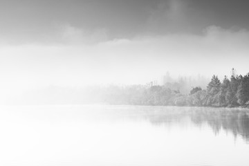 Abstract contemporary art, fog over lake