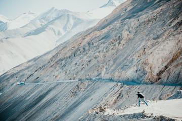 A photographer taking photos of Himalayas range in Ladakh , India