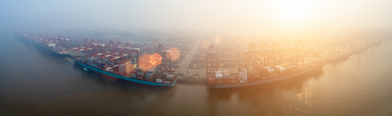 container terminal in morning fog