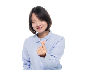 portrait of a beautiful asian businesswoman smiling and showing mini heart sign hands. Isolated on white background