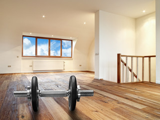 Interior with wooden floor and dumbbells in foreground
