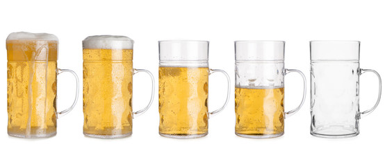Five Glass Mugs with Beer Sorted From Full to Empty