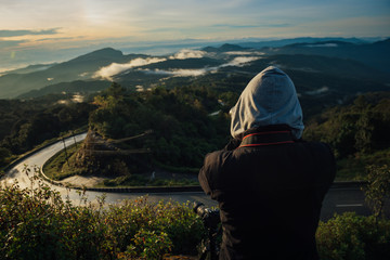People take a picture of mountains, morning.