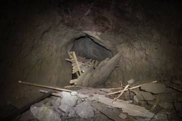 Underground abandoned ore mine shaft tunnel gallery collapsed