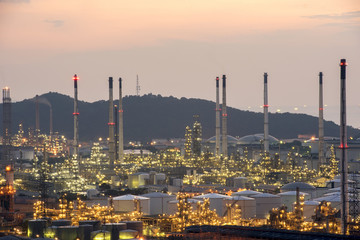 Aerial view Oil refinery.Industrial view at oil refinery plant form industry zone with sunset and cloudy sky.