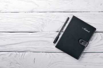 Office work space, notebook. On a wooden surface. Top view. Free space for your text.