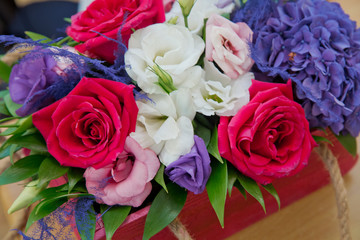 Colorfull roses. Close-up photo of a red, whitw and roses roses bonteque backgrounds. Rose in Valentine's day