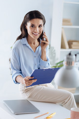 Attractive cheerful businesswoman discussing work