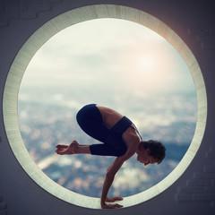 Beautiful sporty fit yogi woman practices yoga asana Natarajasana - Lord Of The Dance pose in a round window