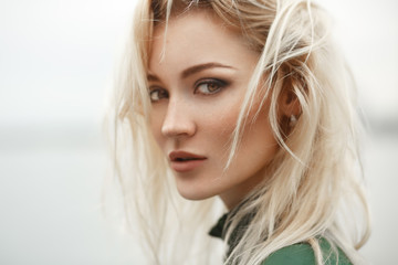 Profile of stunning blonde with deep hazel eyes