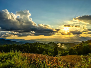 The beautiful nature landscape where the great sunlight is shining before sunset above the green nature of the mountain at Doi Samer Dao, Nan, Thailand. Such a nice place to be visited