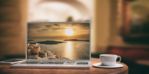 Laptop with Santorini island background. Blurred coffee shop background. 3d illustration