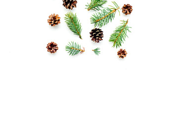 New year symbols pattern. Spruce branches and cones on white background top view copyspace