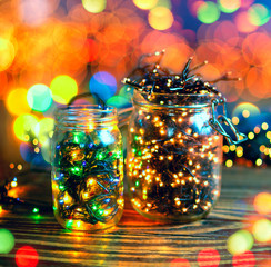 Christmas lights in a jars, concept of Christmas time, selective focus. Square