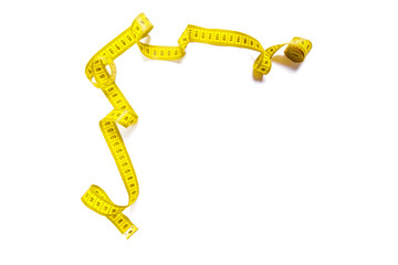 yellow metric measuring tape isolated on white panorama background