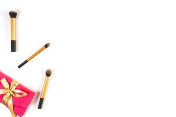 Make up brushes and make up bag on white background