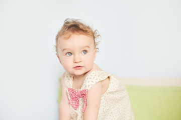 Happy little child girl sit on white towel happy emotion and face expression