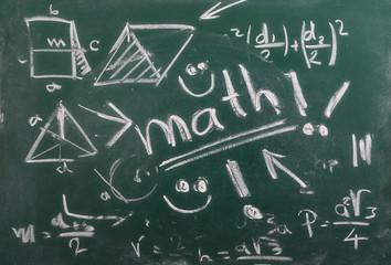 Mathematical equation on chalkboard, blackboard texture