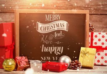 Chalkboard Surrounded by Christmas Gifts Mockup 2