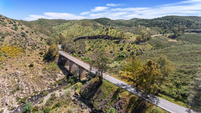 Aerial. Terrain of Alentejo, shooting from the drone.. Road to the village of Mertola.